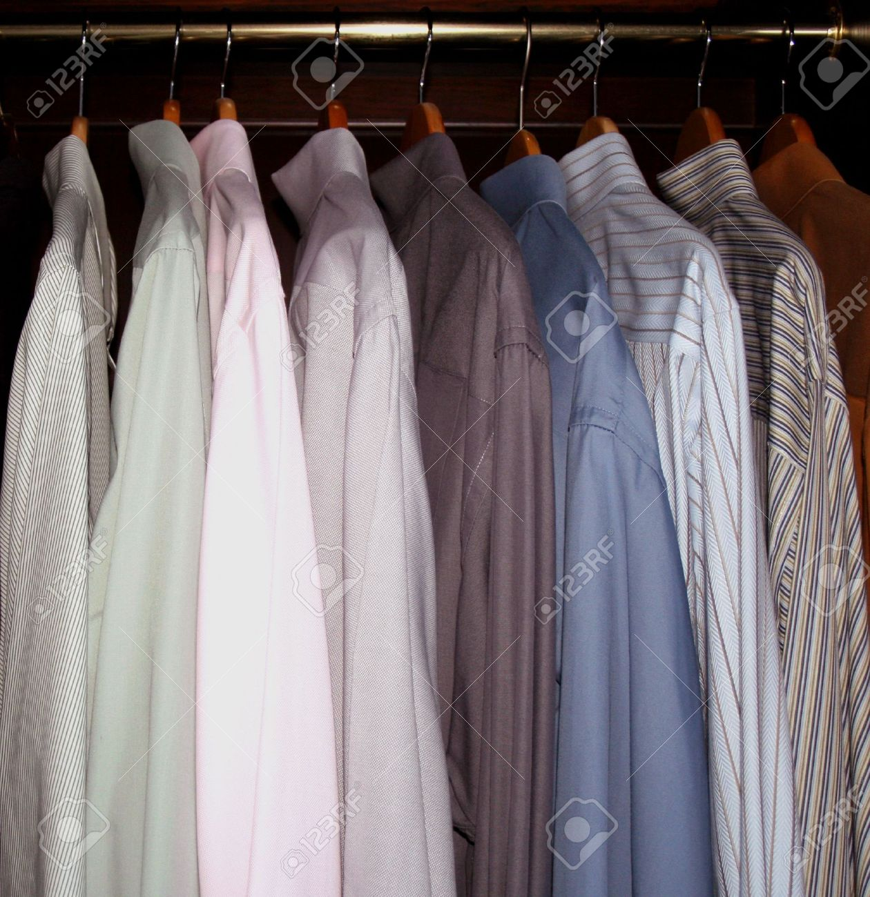 menu0027s dress shirts hanging in wardrobe closet stock photo