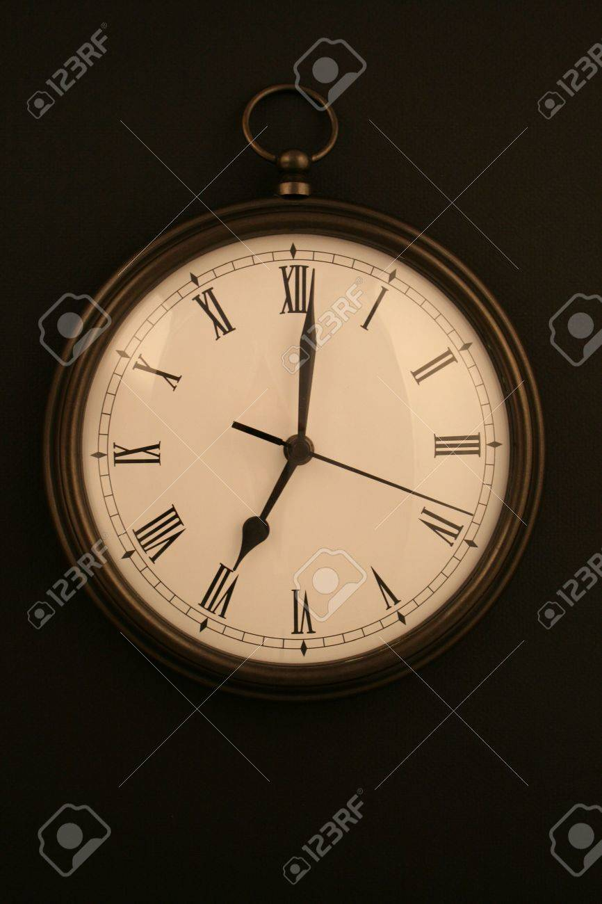 Bronze pocketwatch style clock at 7 oclock stock photo picture bronze pocketwatch style clock at 7 oclock stock photo 2020276 amipublicfo Images