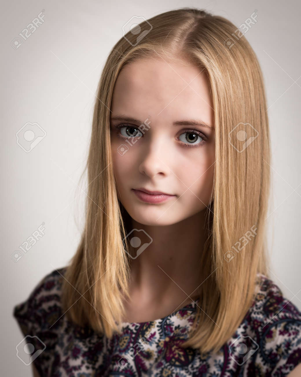 Portrait Of A Beautiful Young Teenage Girl With Long Blond Hair