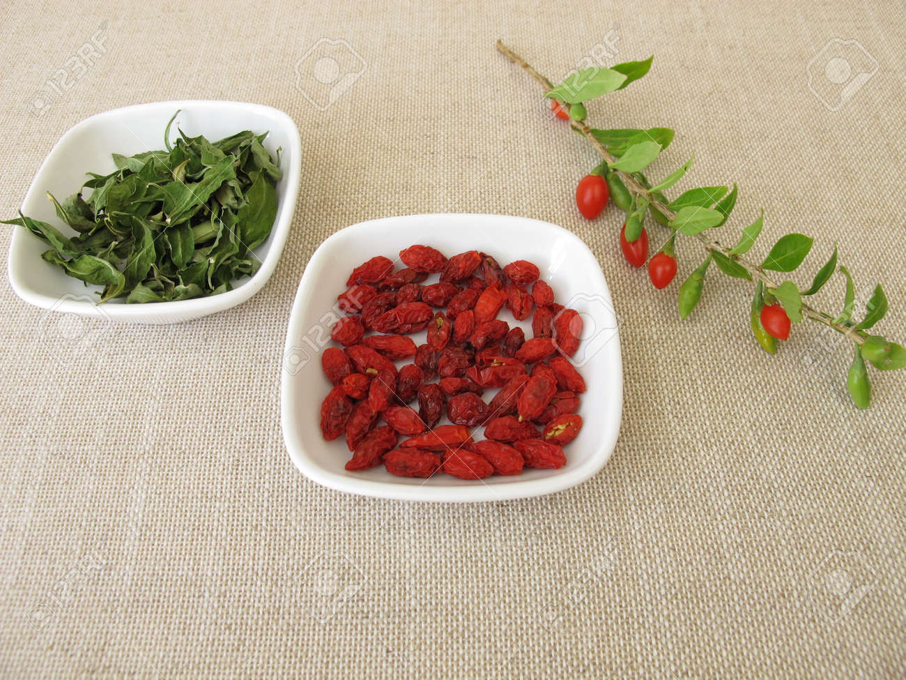 Dried Goji Berries And Goji Leaves Stock Photo Picture And