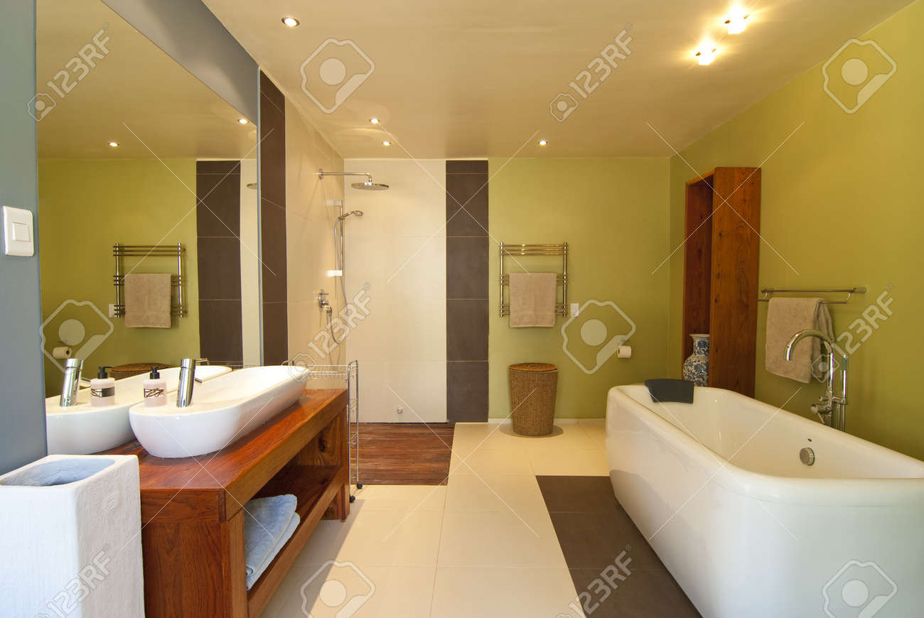 Modern Bathroom With Pastel Coloured Walls And White Bath Theres Also A Wood Floored Open