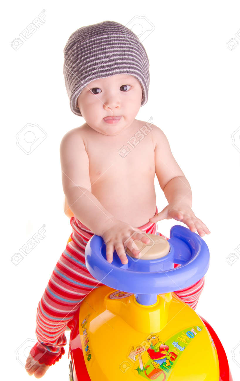 baby and toy - baby boy governs toy car Stock Photo - 15492490