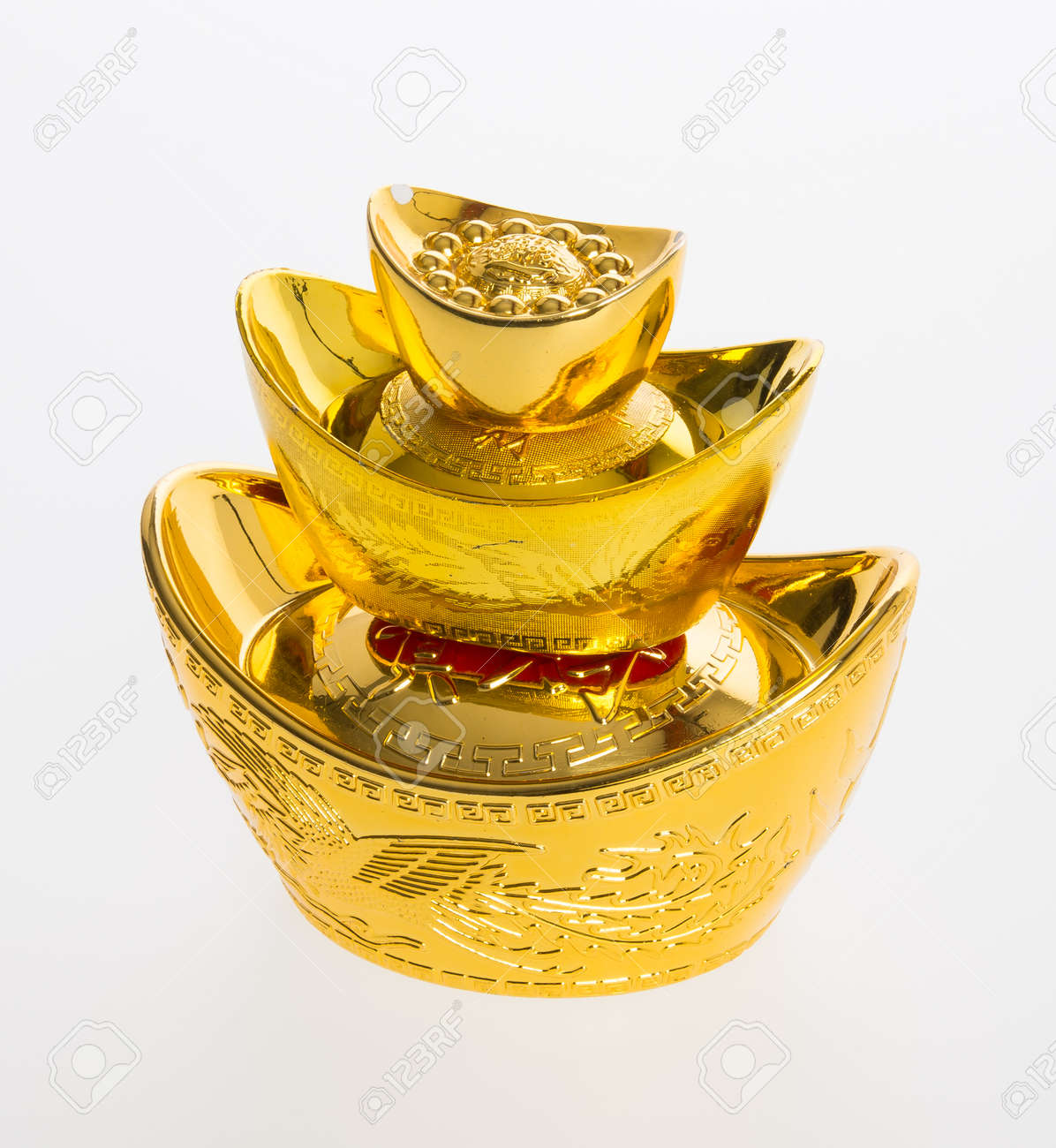 Gold or chinese gold ingot mean symbols of wealth and prosperity gold or chinese gold ingot mean symbols of wealth and prosperity on a background stock photo biocorpaavc Images