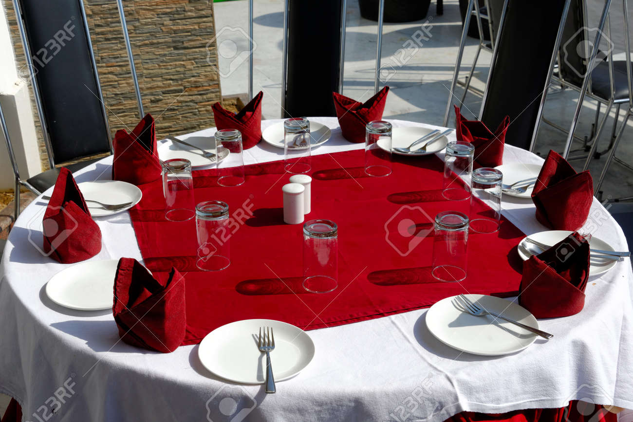 Admirable Table Glasses Forks Plates Napkins On Red And White Tablecloths Interior Design Ideas Oxytryabchikinfo