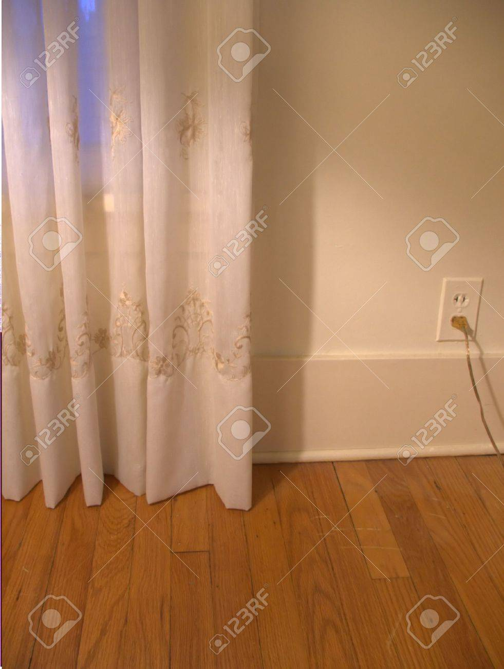 A Home Interior With Cream Colored Curtains Hardwood Floors Stock Photo Picture And Royalty Free Image Image 683884