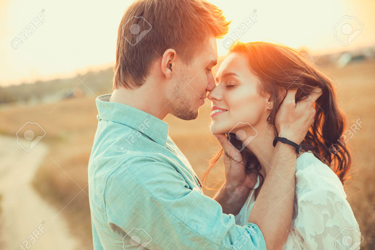 Young couple in love outdoor.Stunning sensual outdoor portrait of young stylish fashion couple posing in summer in field - 54531028