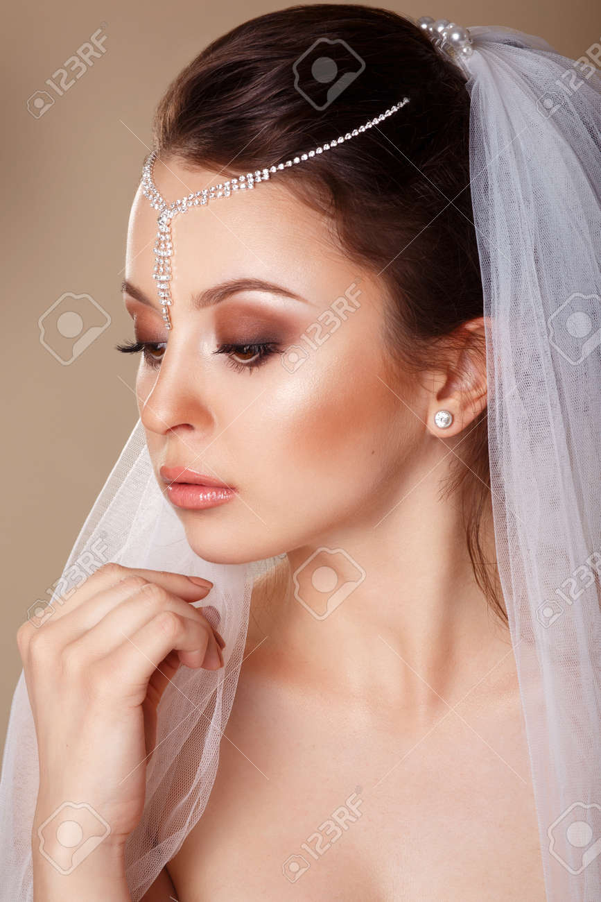 Beautiful Bride With Fashion Wedding Hairstyle With A Tiara In
