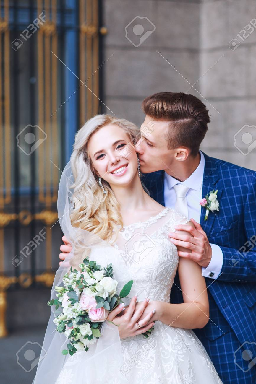 cb3bf839002 Stock Photo - Wedding romantic couple is hugging each other. Beauty bride  with groom