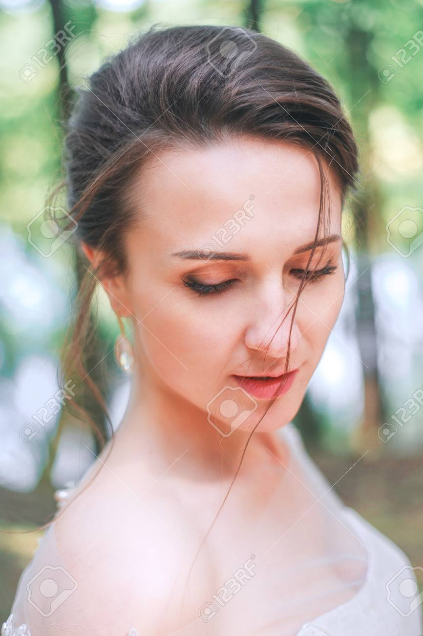 closeup portrait of young gorgeous bride outdoor. wedding makeup..
