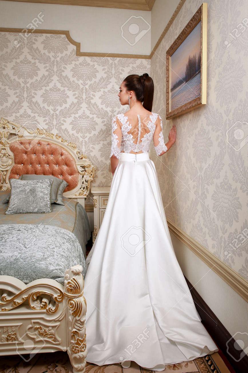 Fashion Bride In Gorgeous Wedding Dress Studio Portrait. Stock Photo ...