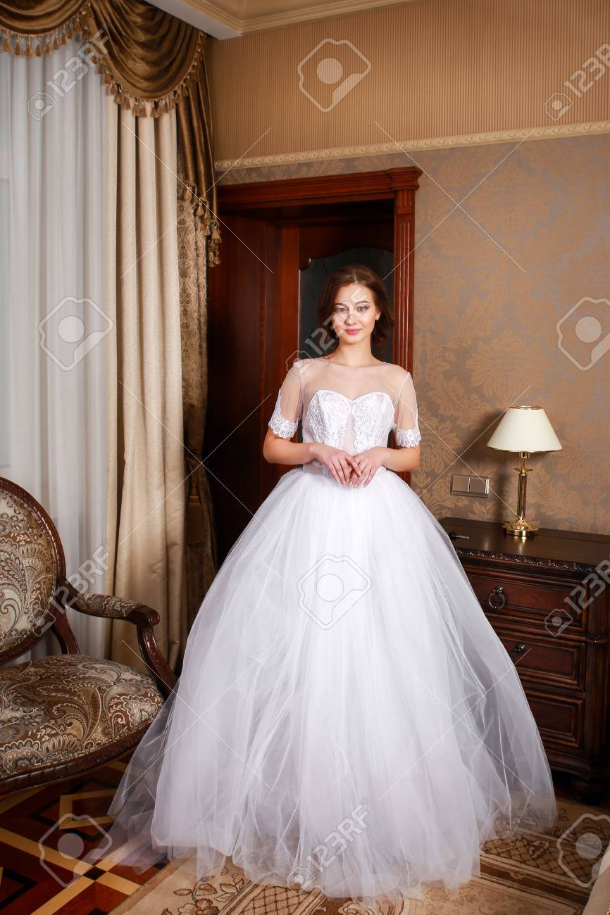 Beautiful Young Bride With Brunette Hairs In A Bedroom Classic