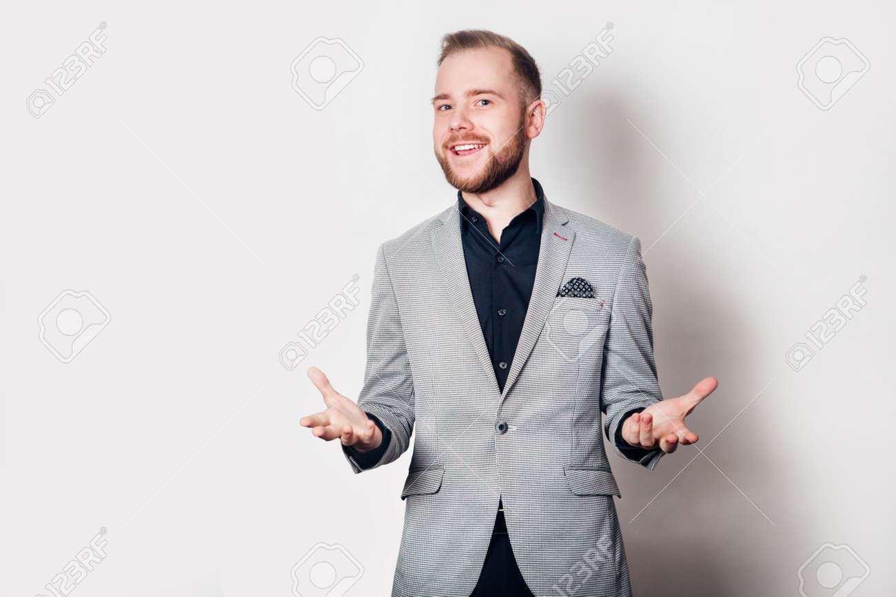 Happy grey suit guy on white background