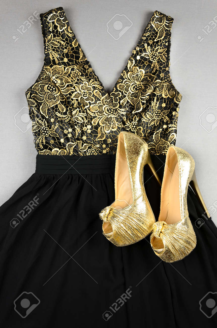Gold High-heeled Shoes And Black Dress