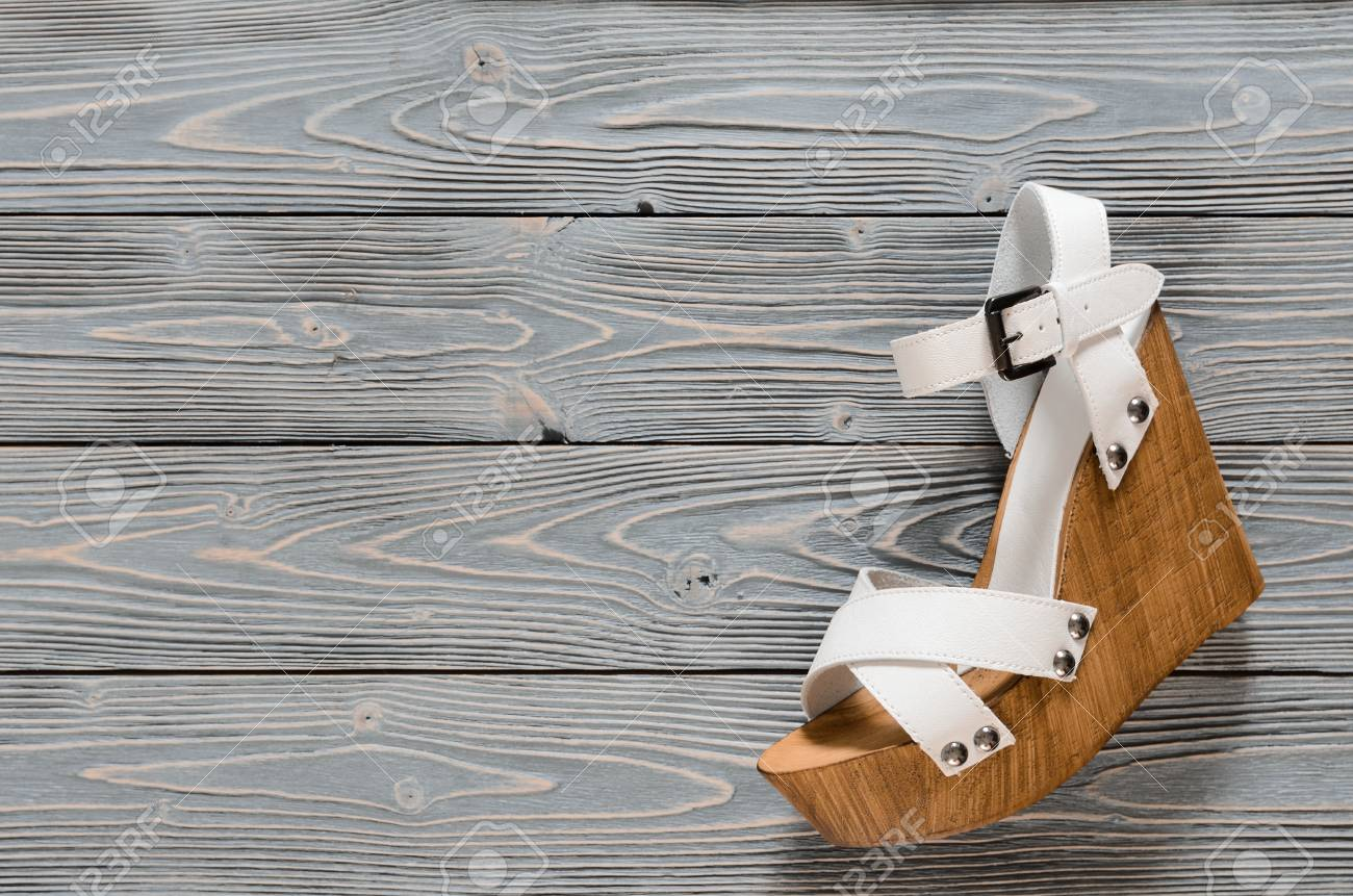 3873e4d223 Stock Photo - Womens shoes (crisscross wood platform wedges) on grey wooden  background. Spring summer collection with copy space. Flat lay. Fashion  concept.