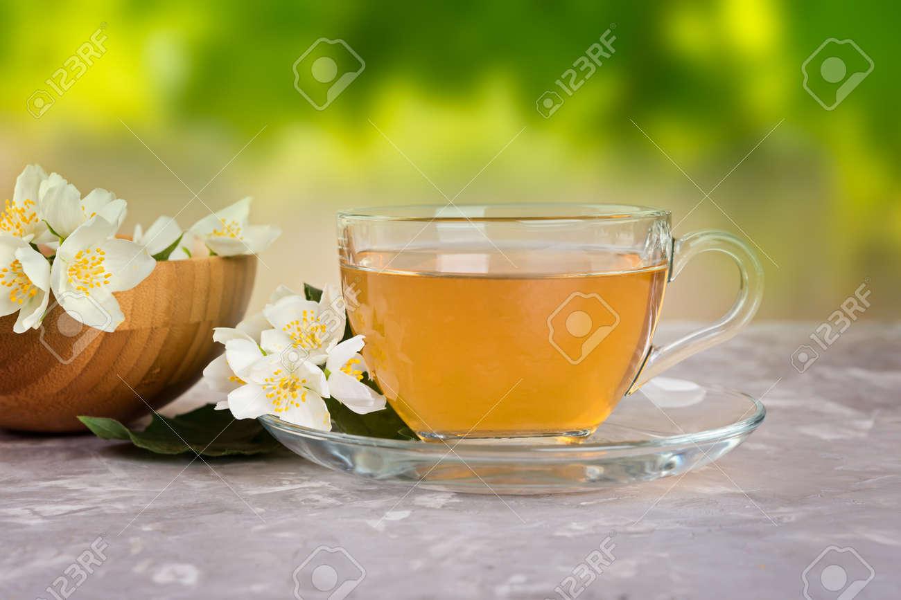 Jasmine Tea With Jasmine Flowers On A Grey Stone Table Stock Photo