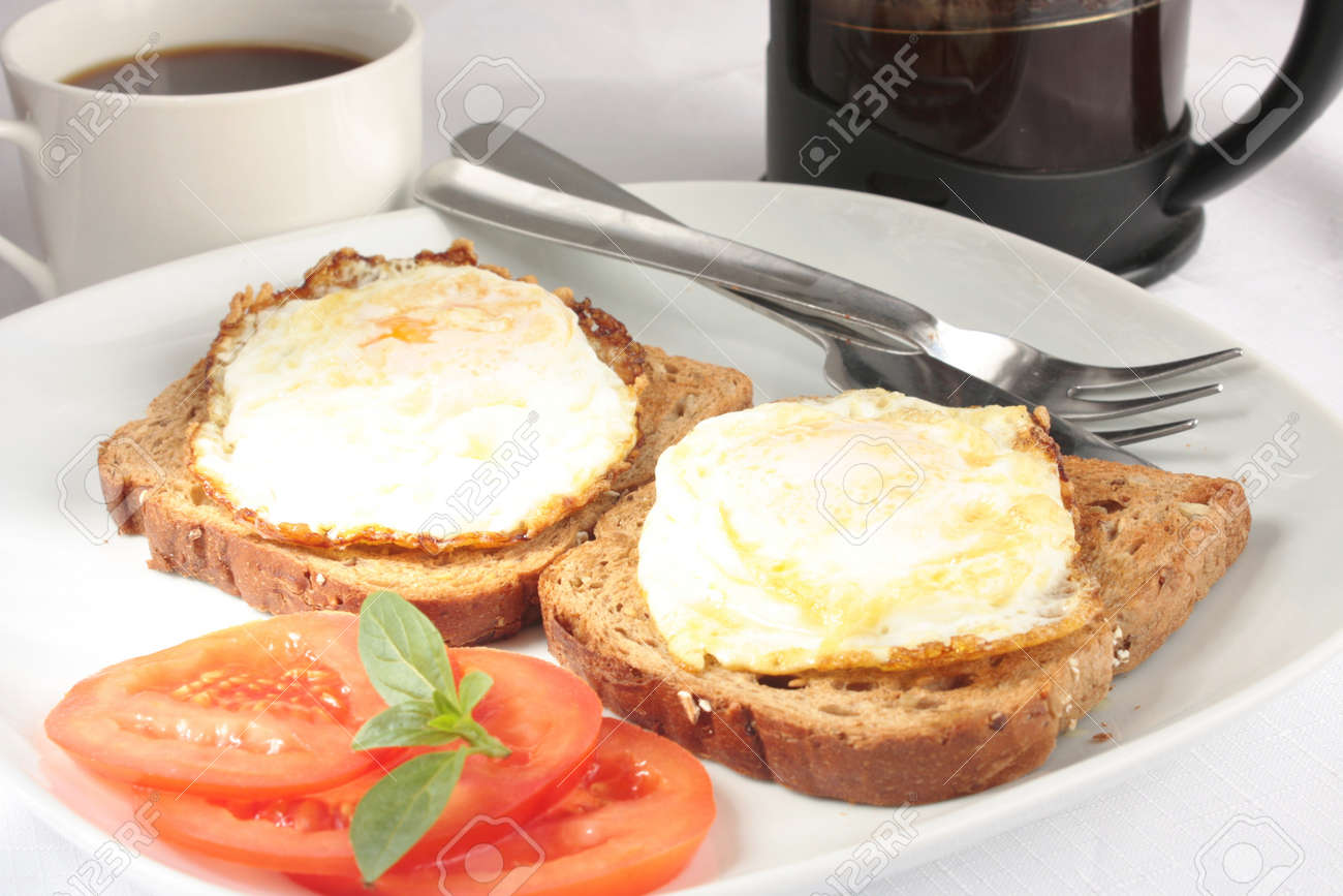 Simple Breakfast Of Eggs On Toast And Coffee Stock Photo