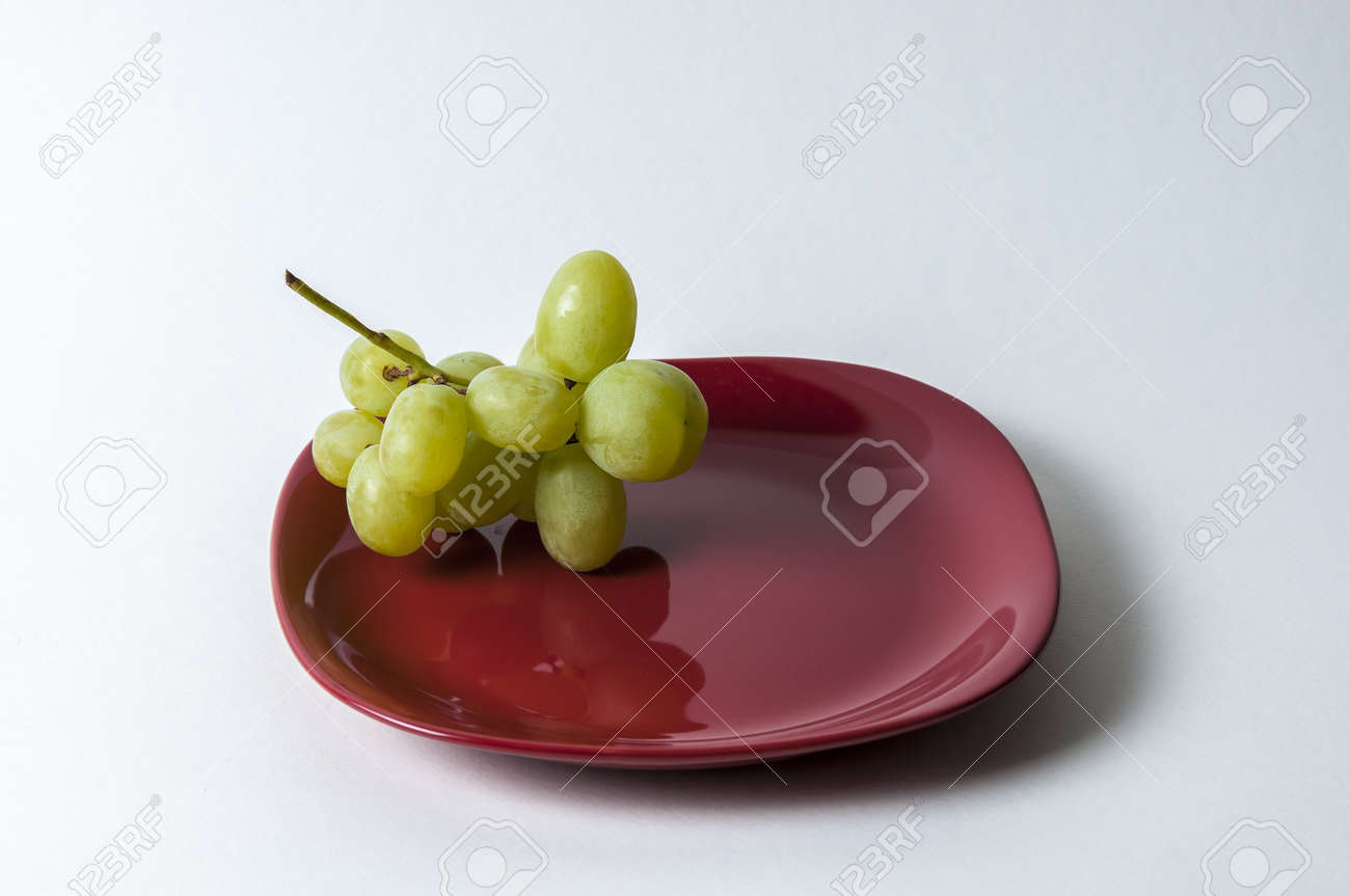 red plate with grape set-up Stock Photo - 16829843