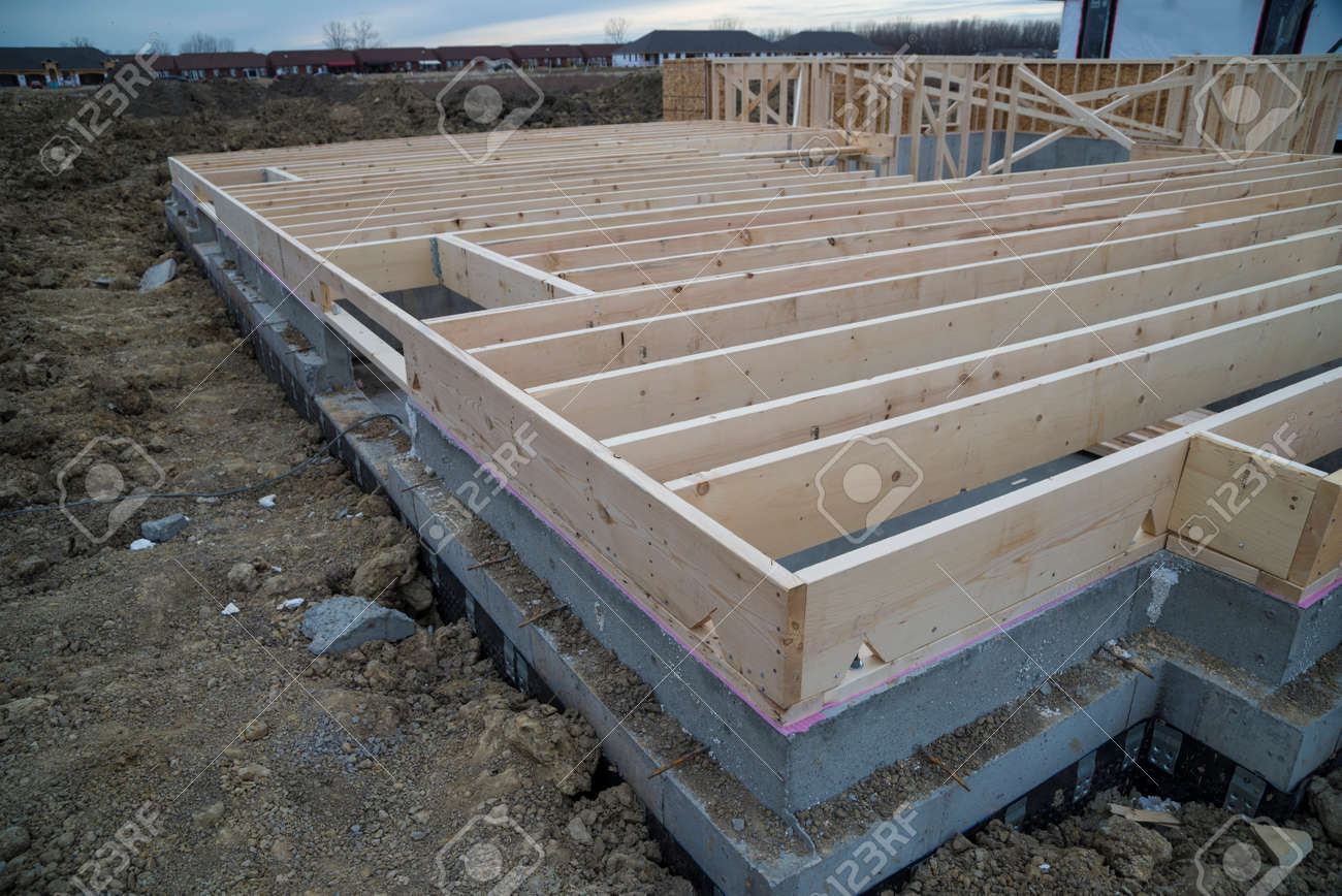 Wood Floor Joist On Top Of Basement Foundation Wall. Stock Photo   74857965