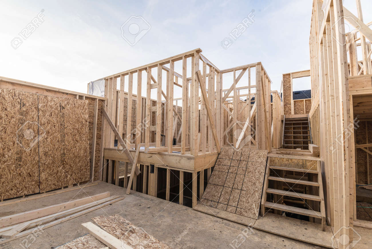 framing a wall. House Framing Wall Studs On Unfinished House. Stock Photo - 75781418 A