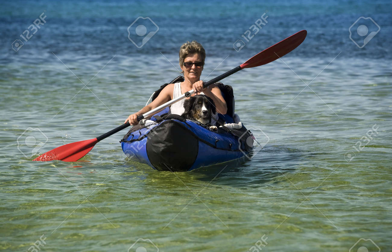 kayak woman and dog stock photo picture and royalty free image