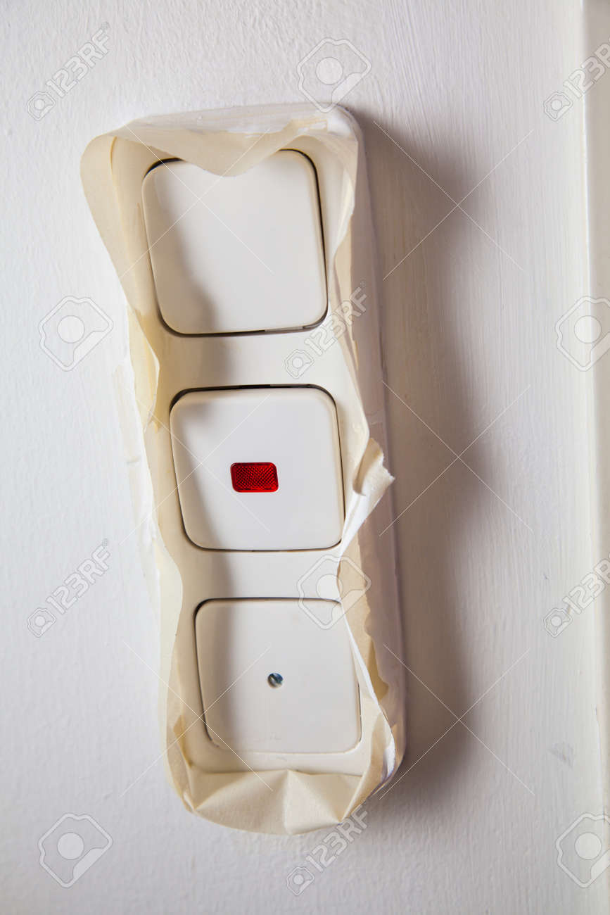 Light Switch With Paint Cover Tape To Prevent Painting The Light Switch  With Color. Stock