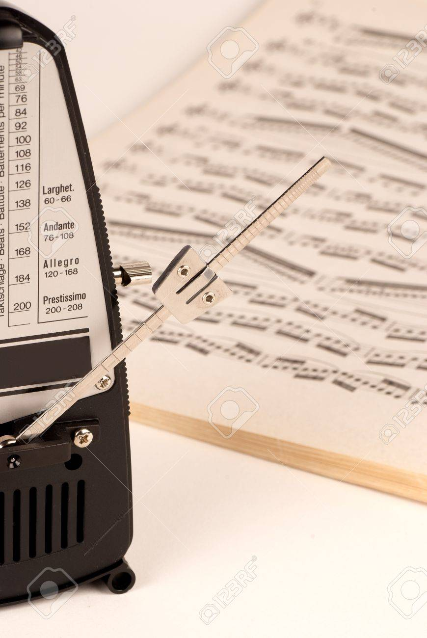 Mechanical metronome working  with a scire in the background Stock Photo - 7160252