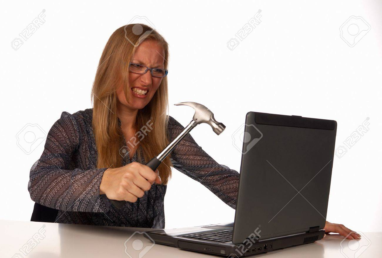 Furious secretary attempting to trash her hated laptop Stock Photo - 7590855
