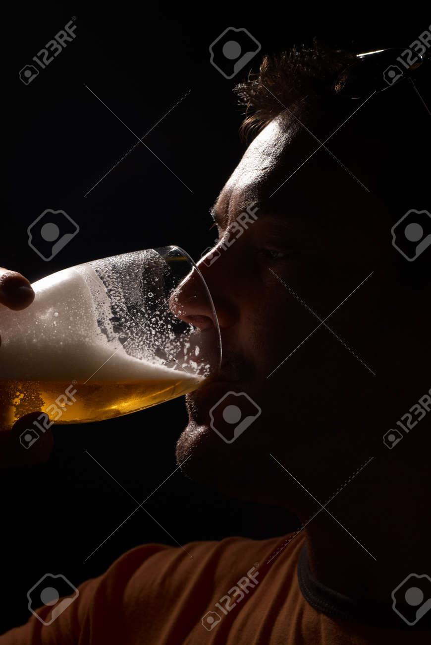 Silhouette portrait of a man enjoying a pint of beer Stock Photo - 7654277