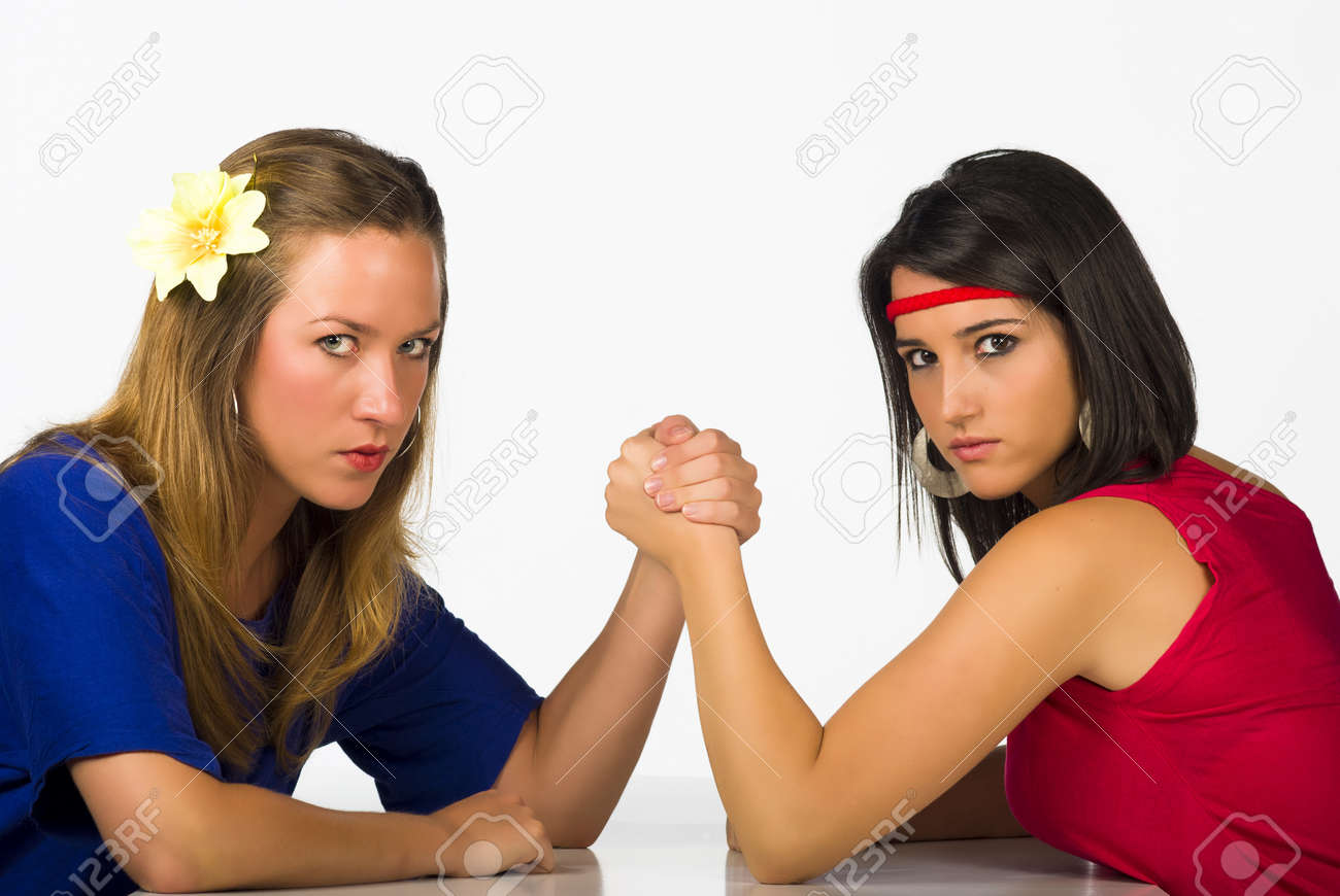 Blond and Hispanic girl competing by arm wrestling Stock Photo - 9816830