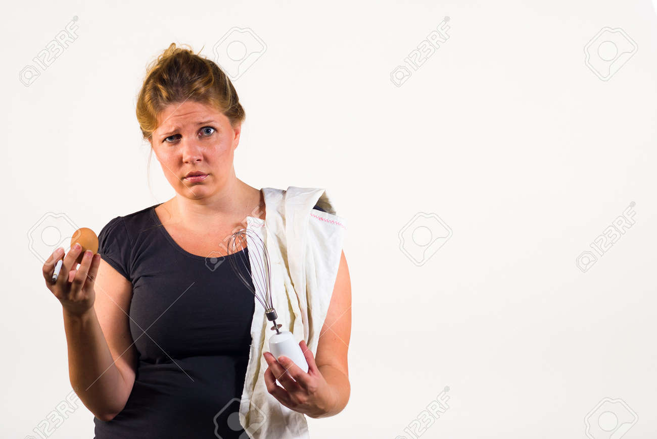 A messy woman totally overwhelmed when having to deal with an egg Stock Photo - 10303995