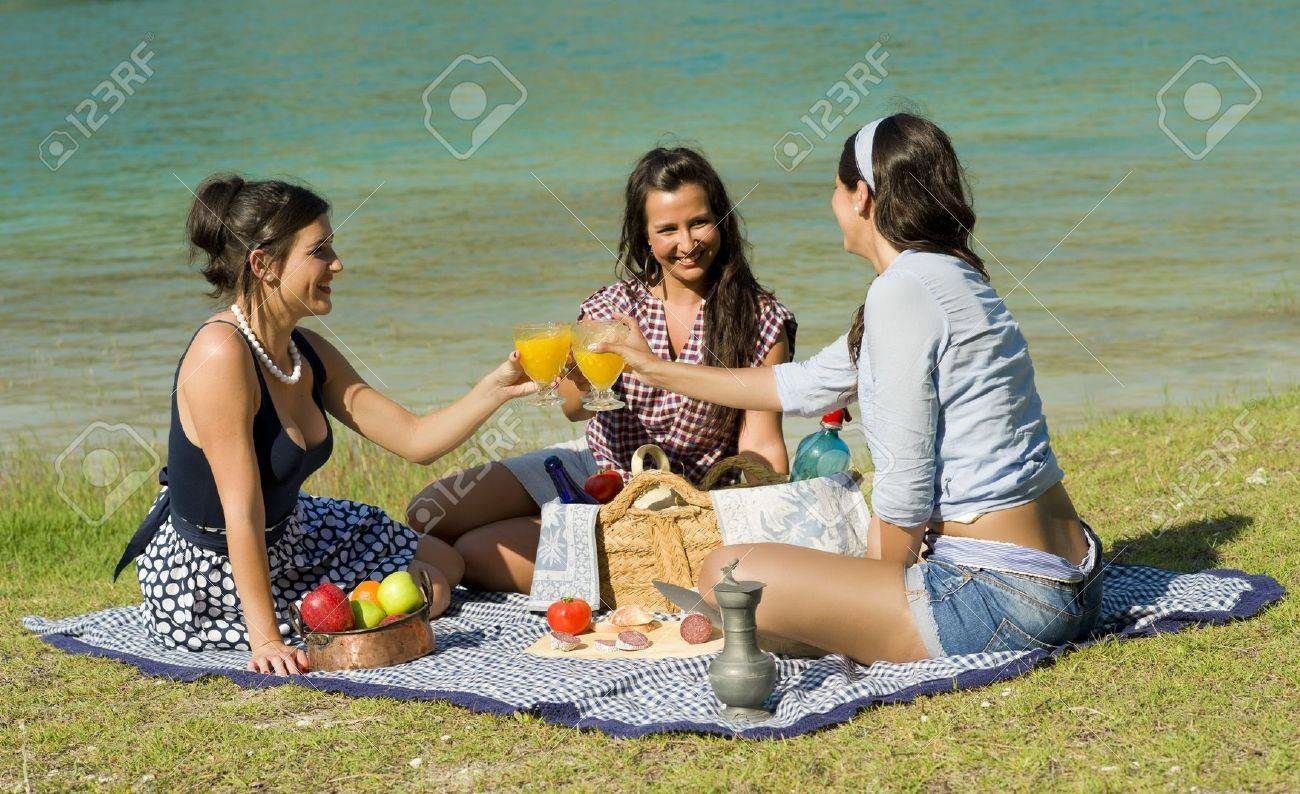 Girls  enjoying a classic  picnic  in a scenic setting Stock Photo - 10446546