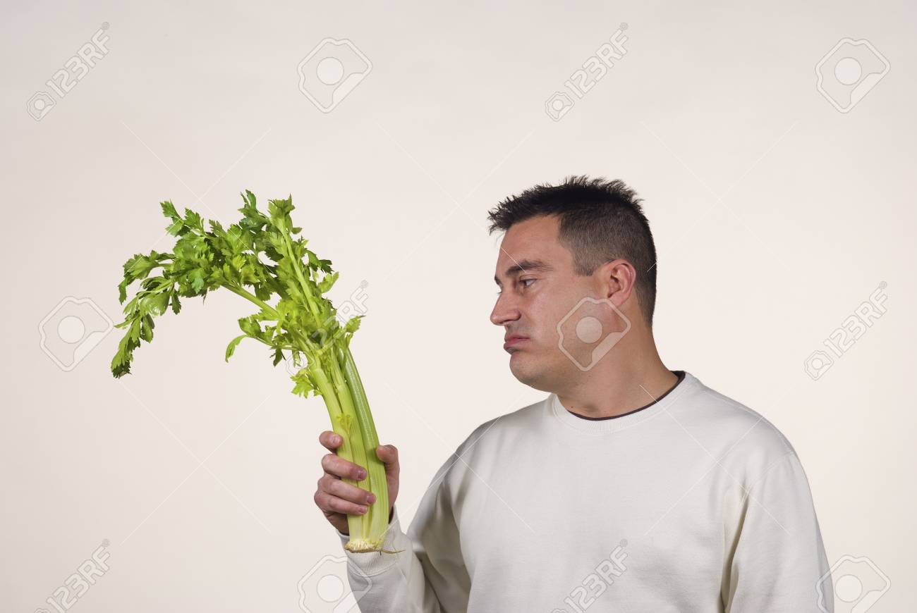 Guy not too pleased with his vegetables Stock Photo - 12625250