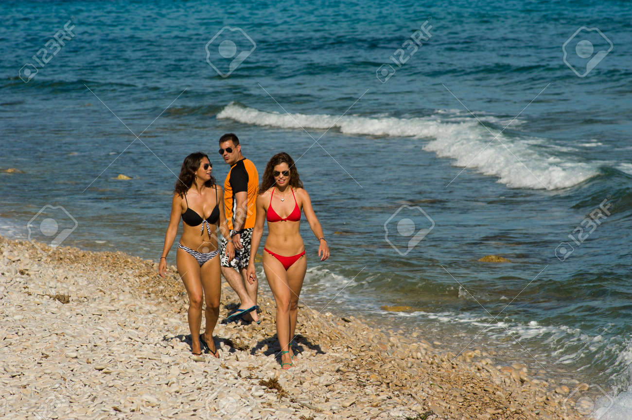 Guy really liking what  he is seeing on the beach Stock Photo - 14360759