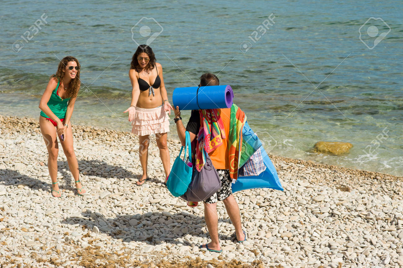 Getting bossy instructions after carrying their stuff to the  beach Stock Photo - 14544564