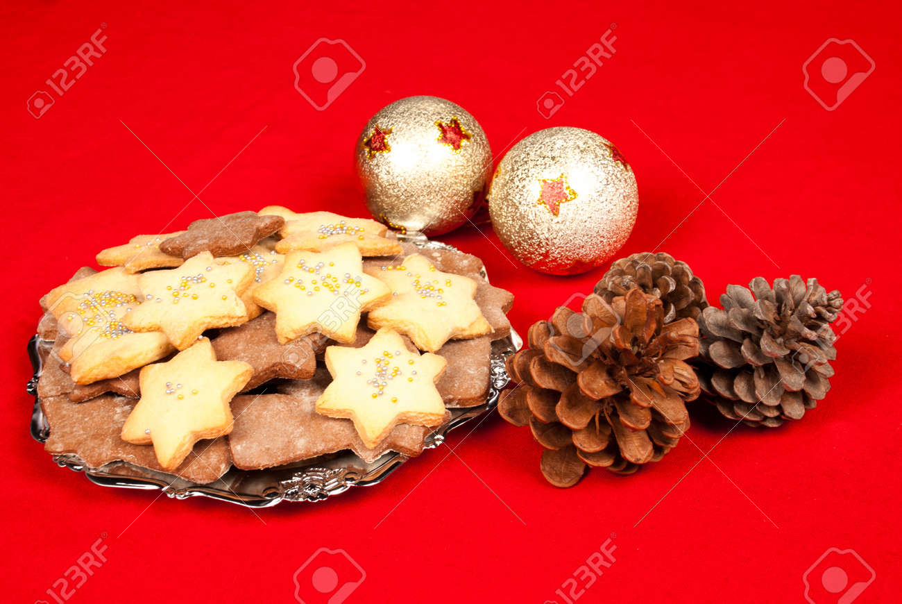 Traditional Christmas Biscuits On A Red Tablecloth