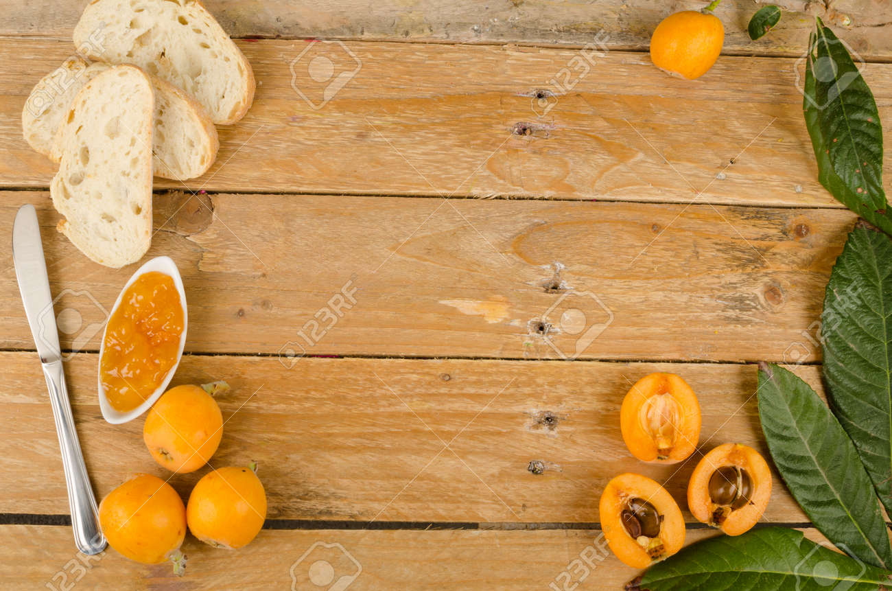Still life with freshly harvested loquats and homemade marmalade Stock Photo - 28824589