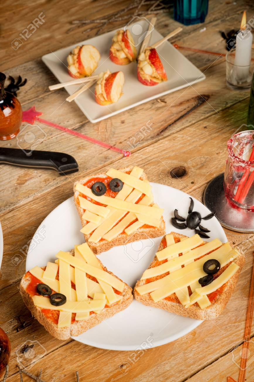 spooky halloween snacks set up on a wooden table stock photo 31406912