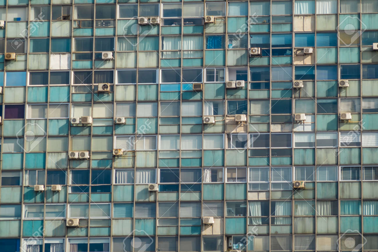 Full Frame Take Of Windows With Air Conditioning Units Stock Photo
