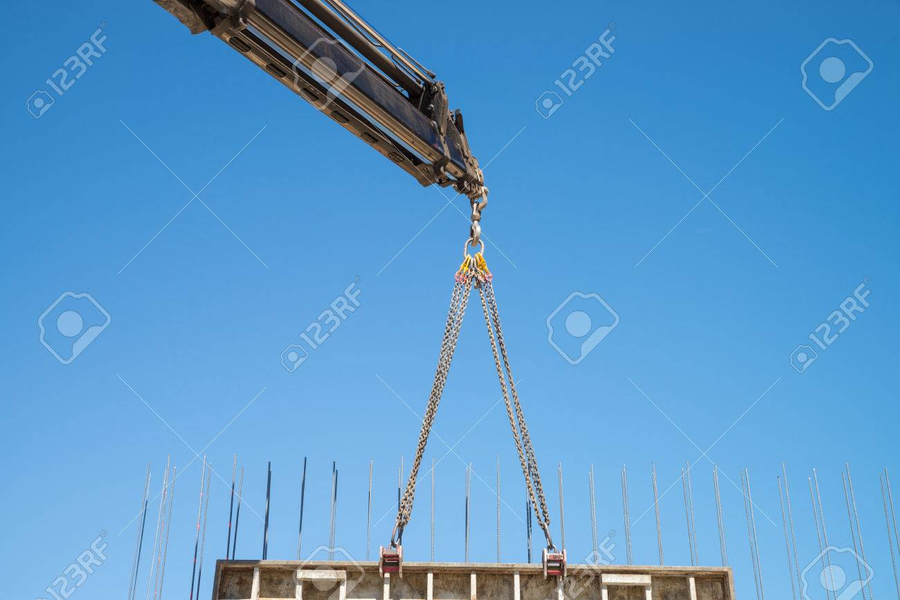 Crane removing a large formwork panel as used for concrete shuttering