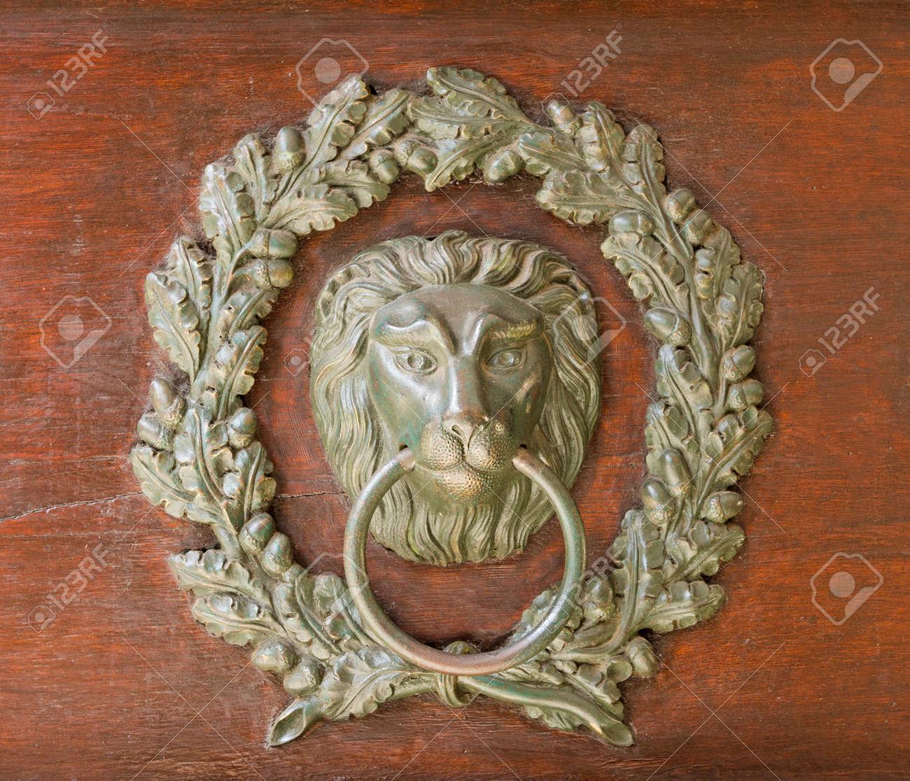 Old Bronze Door Knocker   Lion Head And Oak Wreath Stock Photo   83265296