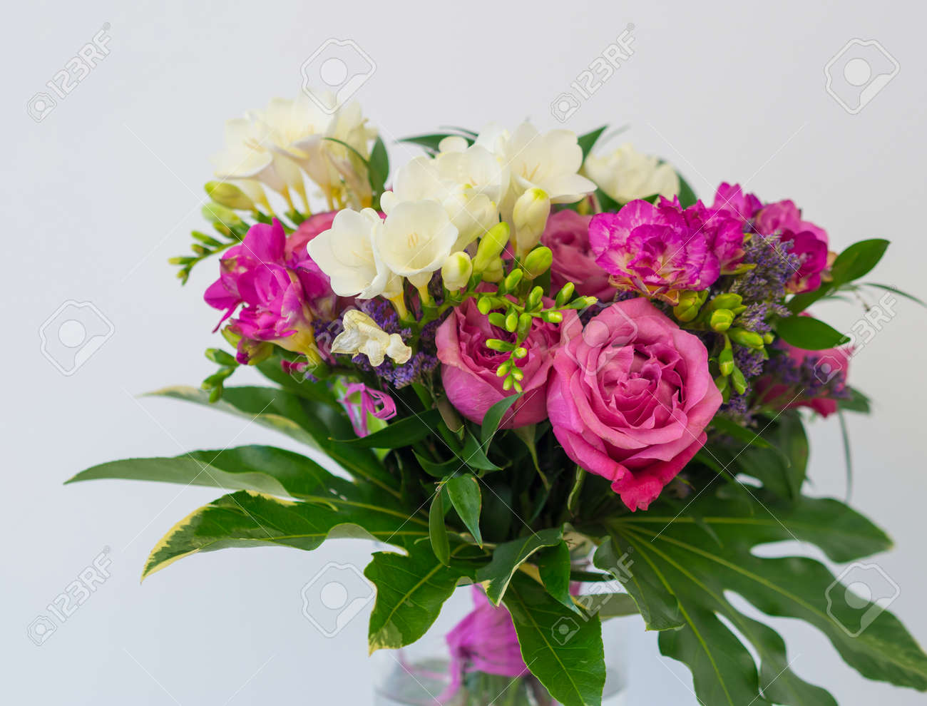 Close Up Pink Rose And White Freesia Flower Bouquet With Green