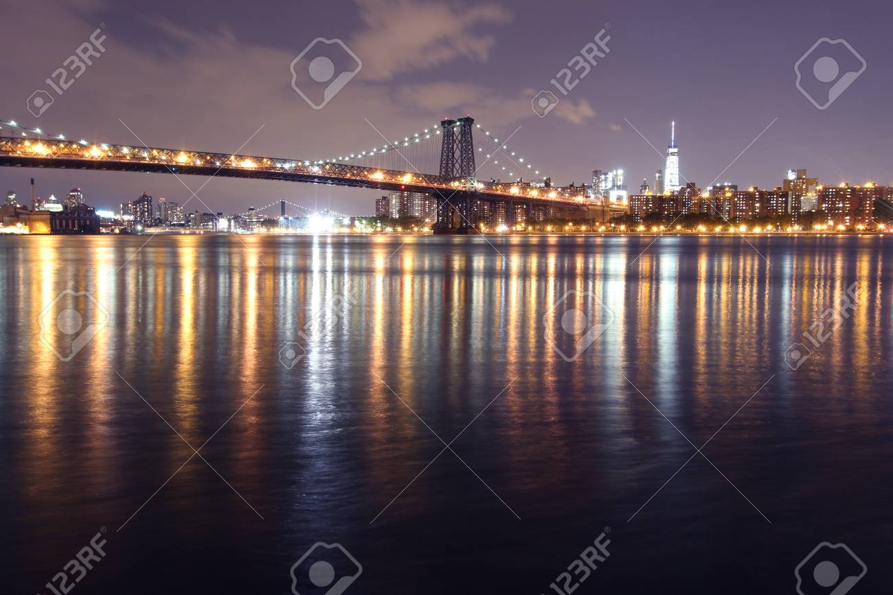 Williamsburg Bridge And Manhattan At Night Time Seen From East