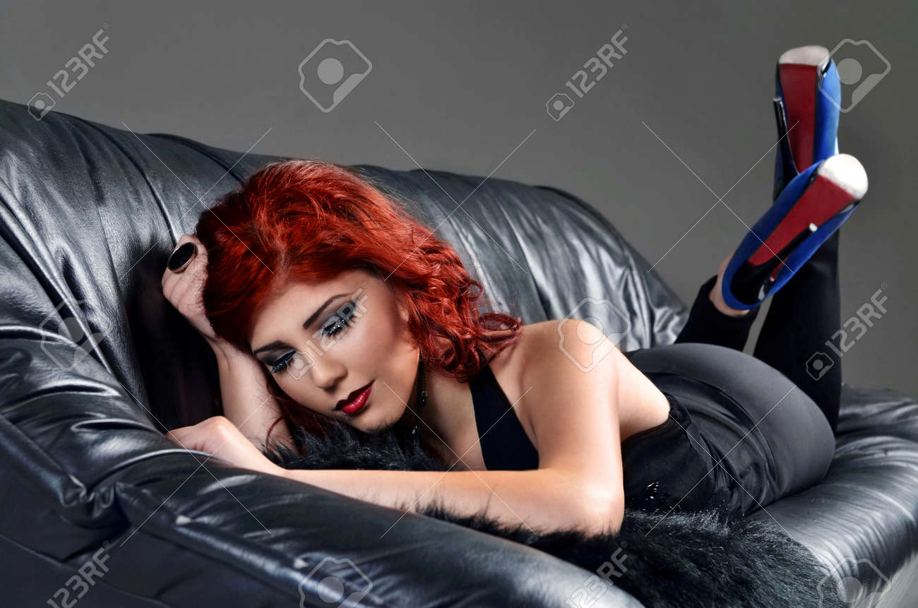 Redhead posing on couch