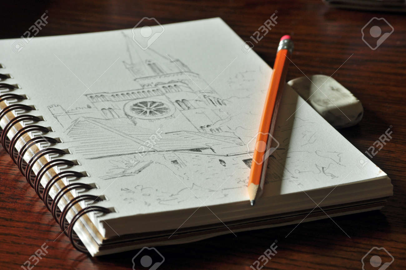 Pencil sketch of church with pencil eraser and sketchbook