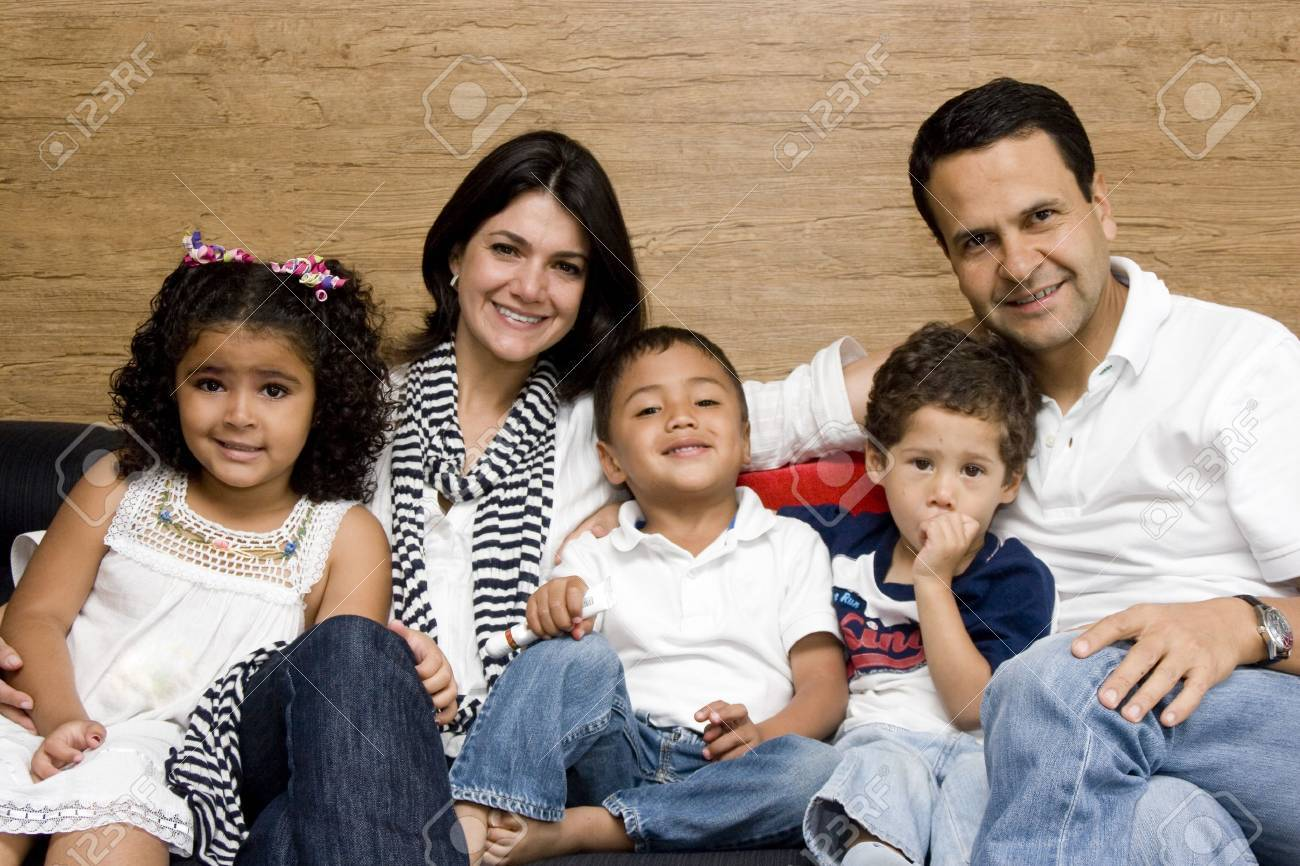 Beautiful family enjoying, mom and dad playing with their children at home Stock Photo - 10909698