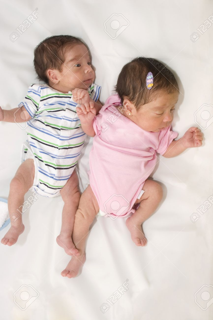 portrait of twin babies boy and girl stock photo, picture and