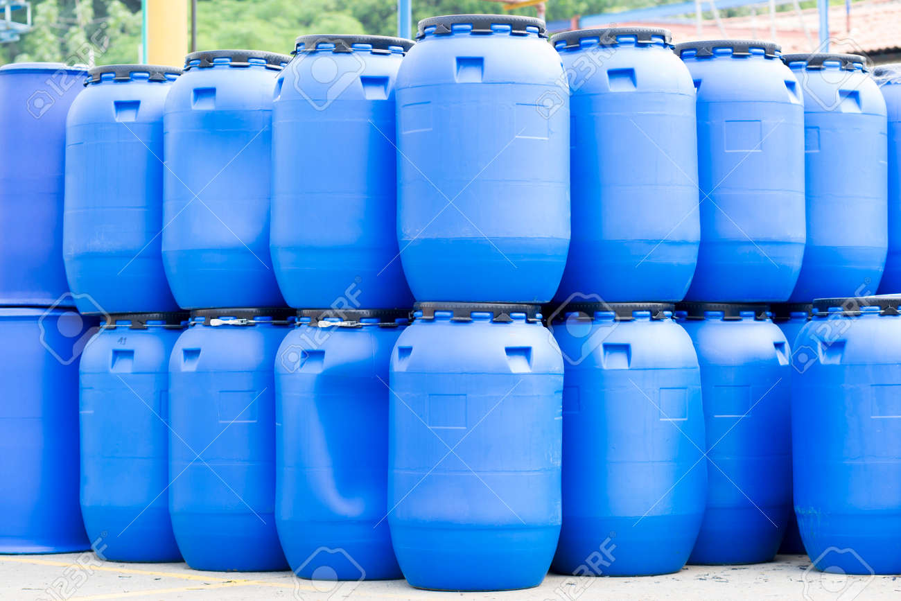Chemical Plant Plastic Storage Drums Big Blue Barrels Stock Photo