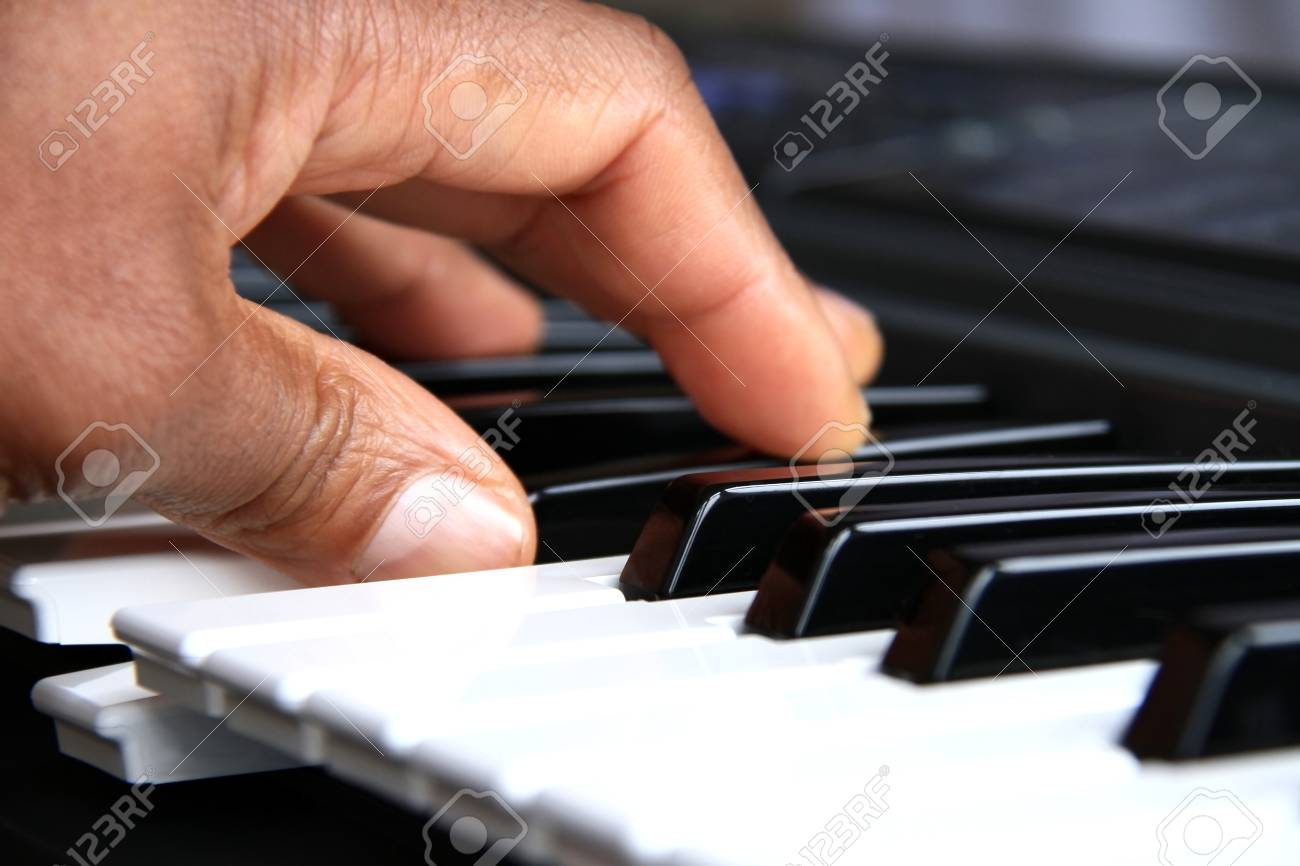 Image of a fantastic piano player playing a chord in a concert