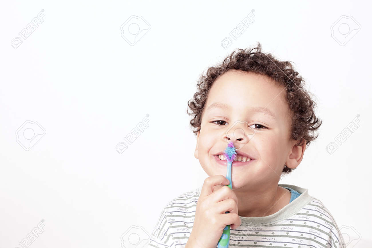 little boy brushing his teeth with an electric tooth brush stock image with white background stock photo - 158506741