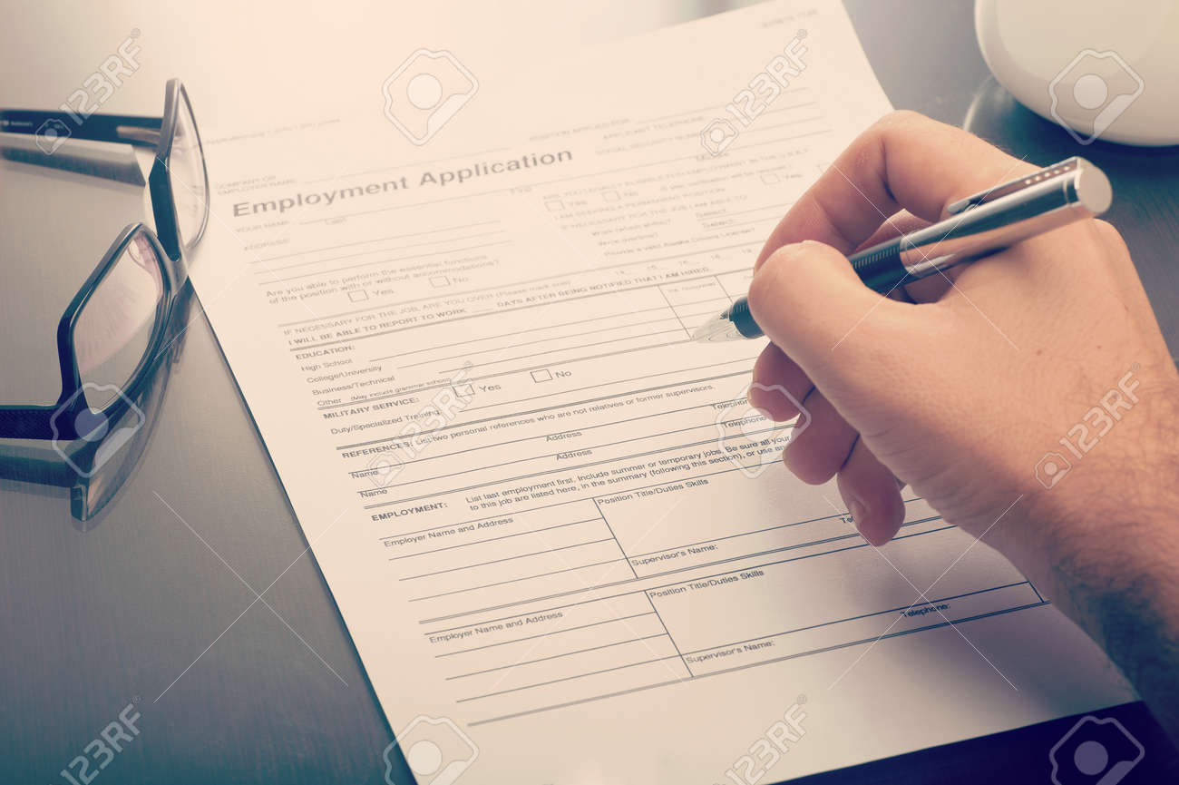 Close Up Of A Man Filling A Job Application Form Stock Photo ...